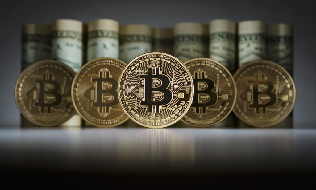El bitcoin una moneda cada vez más aceptada por las entidades bancarias